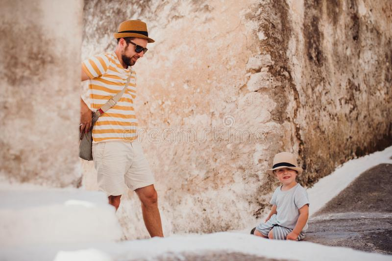 A father with toddler son in town on summer holiday. stock image