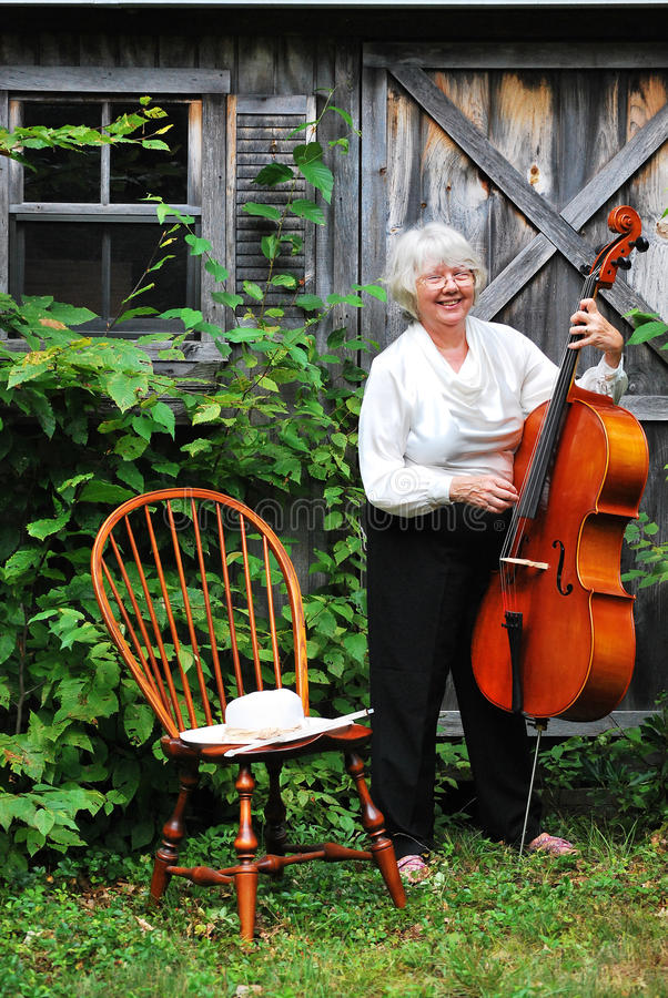 Mature female cellist. royalty free stock photos
