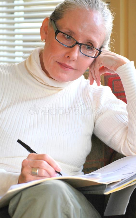 Female counselor working overtime. stock images