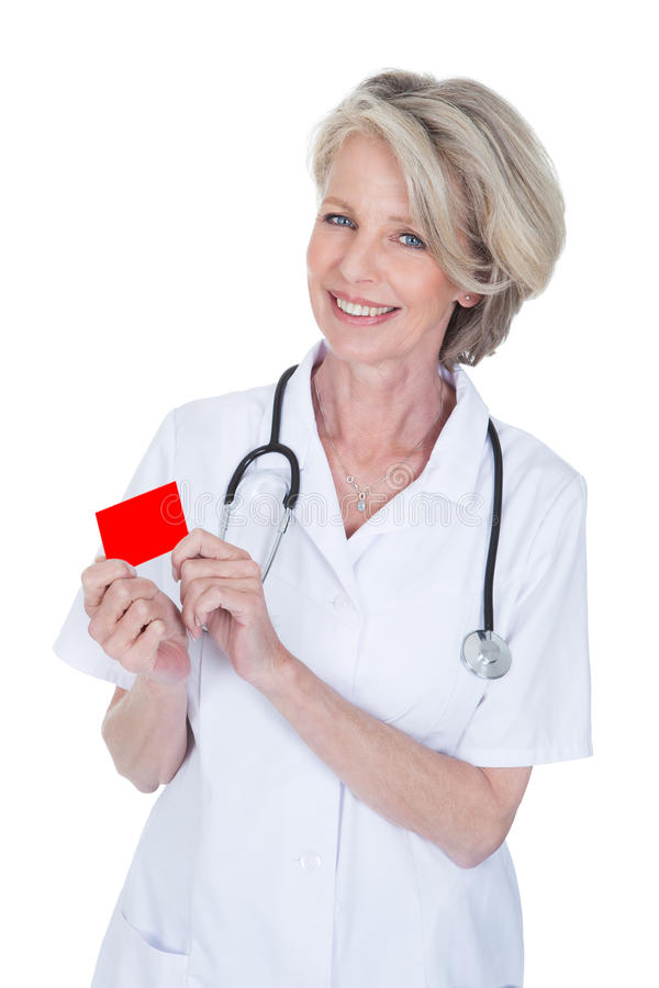 Mature Female Doctor Holding Visiting Card stock image