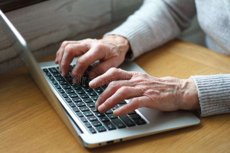 Senior elderly business woman working on laptop stock photos