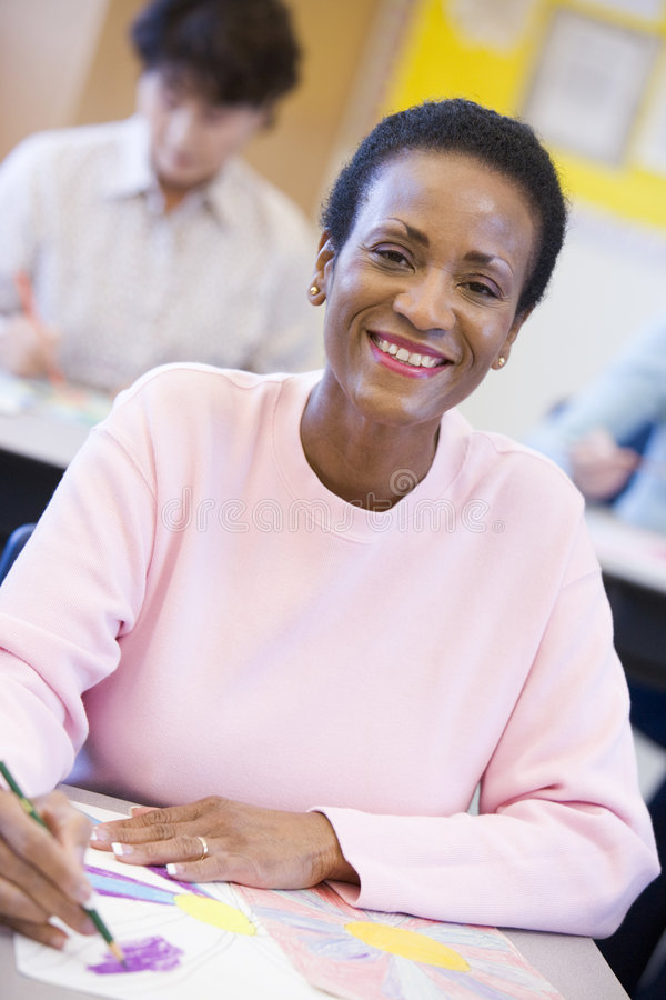 Mature female student in art class.  stock photo