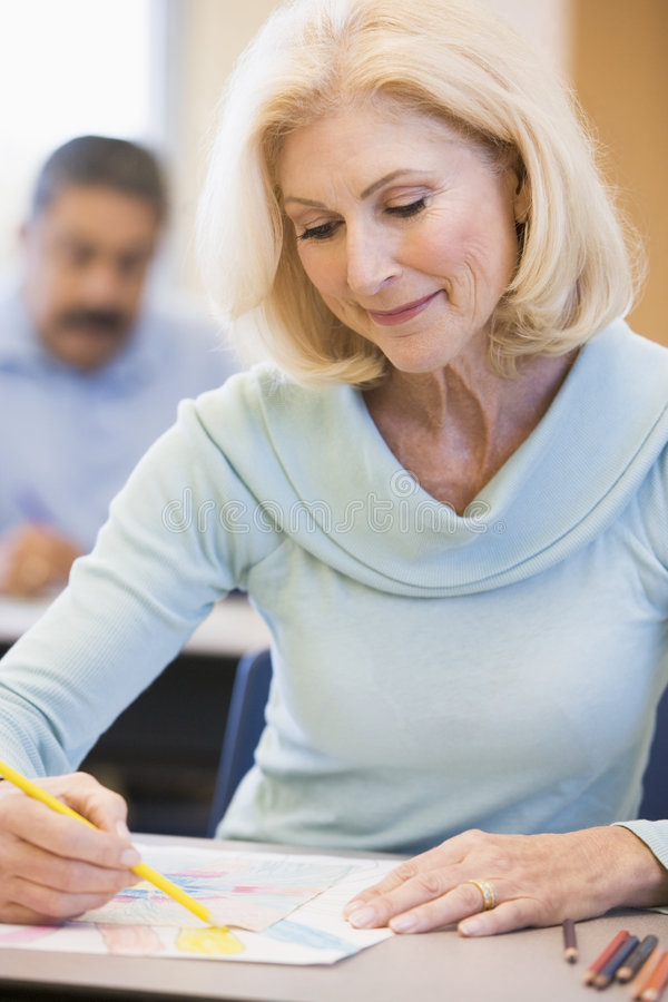 Mature female student in art class.  royalty free stock photos