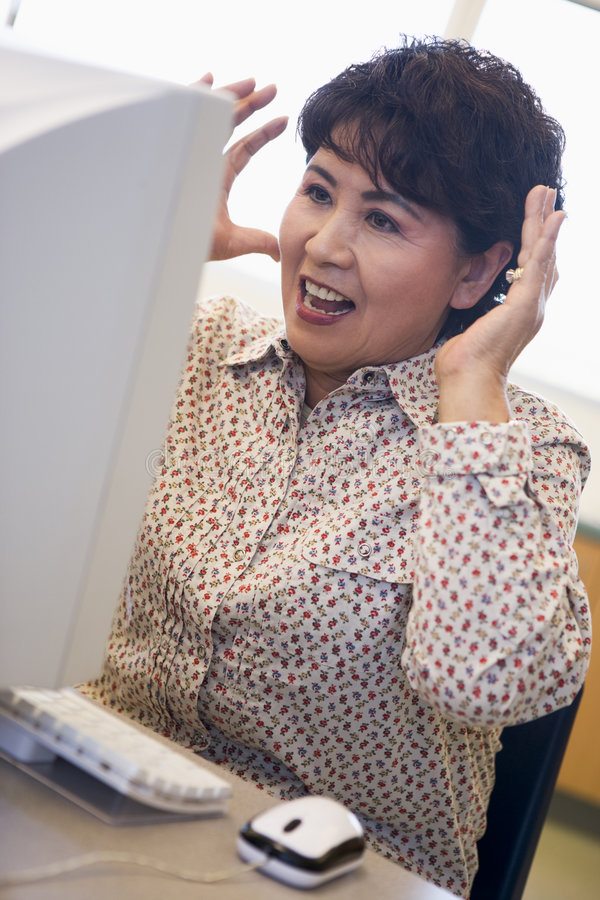 Mature female student expressing frustration royalty free stock photo