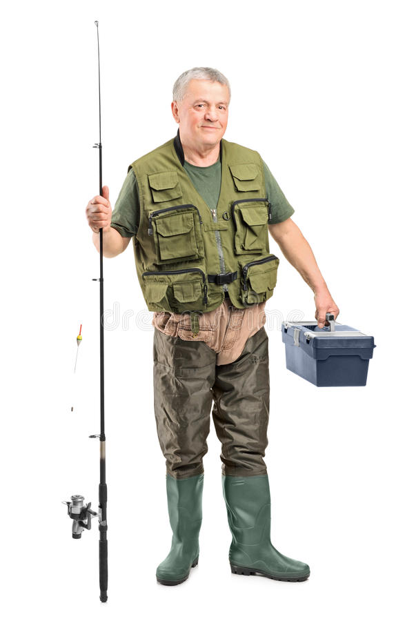 Mature fisherman holding a fishing equipment royalty free stock photos