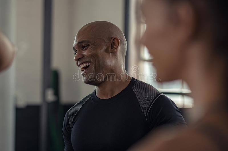 Mature fitness man laughing in gym stock photography