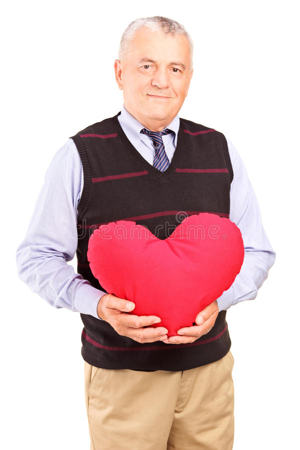Download Mature Gentleman Holding A Red Heart Stock Image - Image: 28577583