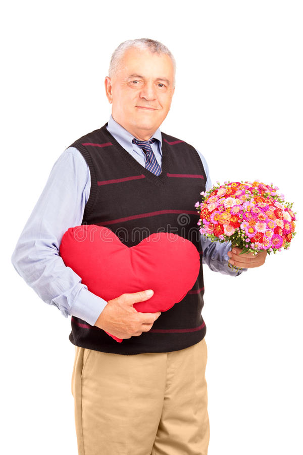 Download A Mature Gentleman Holding A Red Heart And Flowers Stock Photos - Image: 28845533