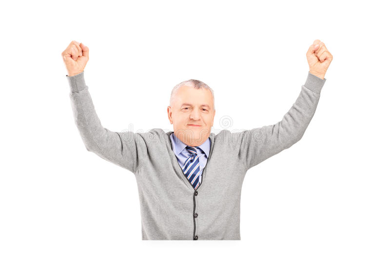 Download A Mature Gentleman Seated On A Table Gesturing Happiness Stock Photo - Image: 30408126