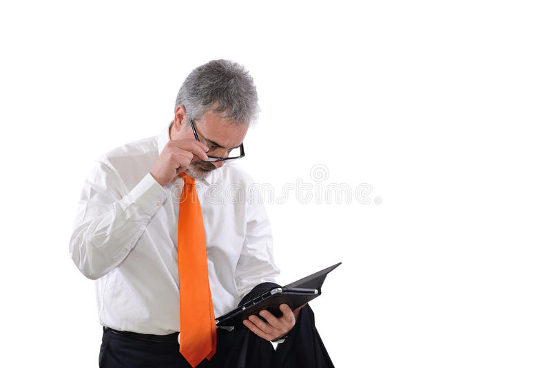 Mature has difficulty reading. Mature business man who has difficulty reading on tablet stock photography