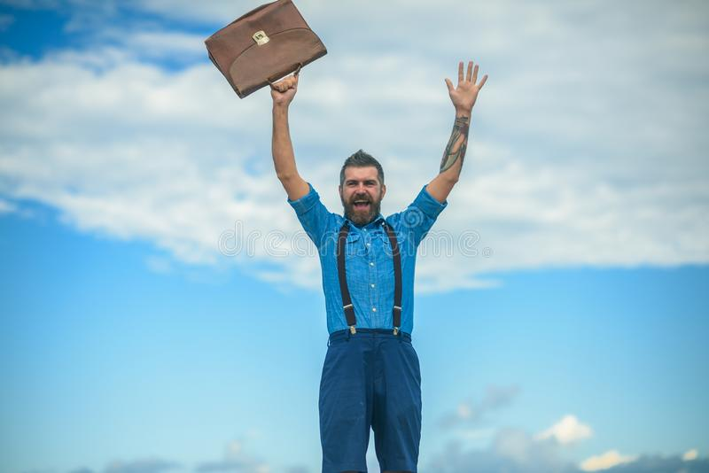 Mature hipster with beard. Brutal male. Vintage fashion bag. Going to work. Businessman. Bearded happy man with retro stock images