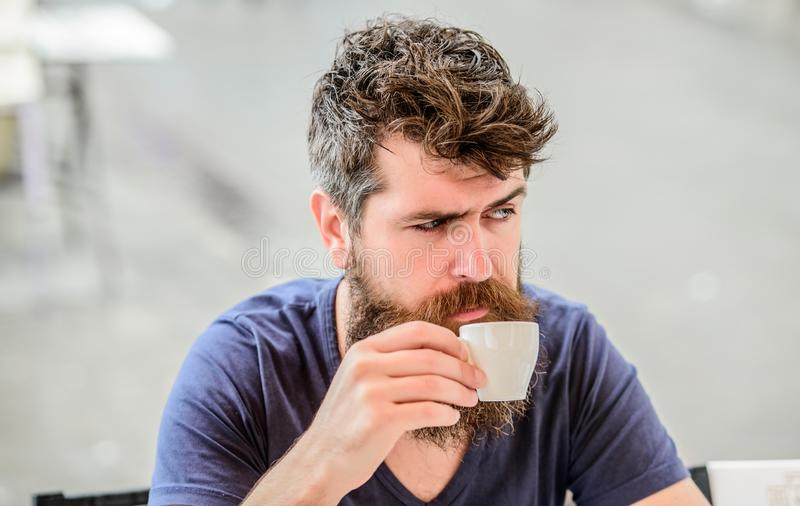 Mature hipster with beard hair drinking coffee. brutal male needs morning refreshment. drink espresso coffee. morning. Breakfast. Bearded man in cafe. What a stock image