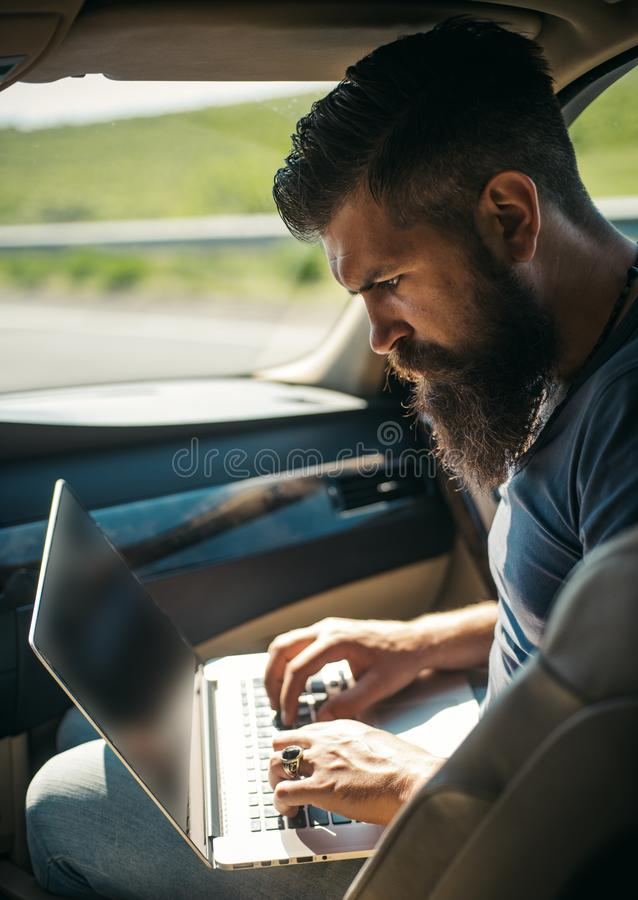 Mature hipster with beard. Male barber care. Bearded man. being late. rush hour. earnings on the Internet. job search stock photography