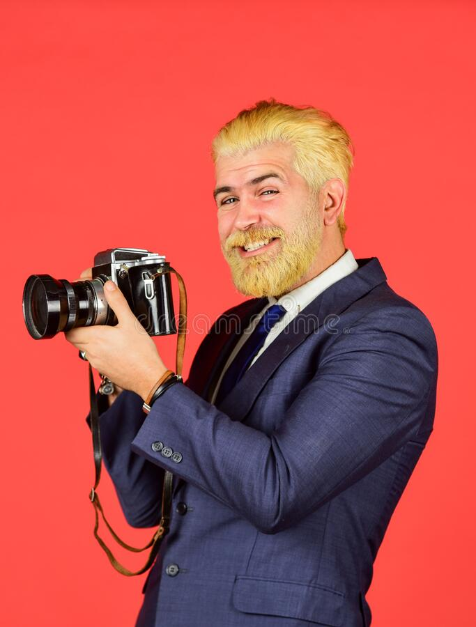 Mature hipster with beard. vintage camera. happy businessman hold retro camera. mature man dyed beard and hair stock photo