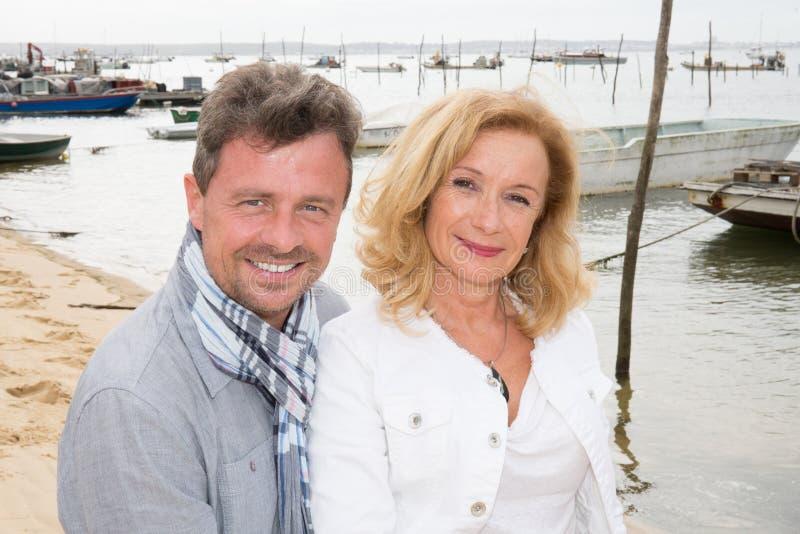 mature holidays Happy couple on sea background royalty free stock photo
