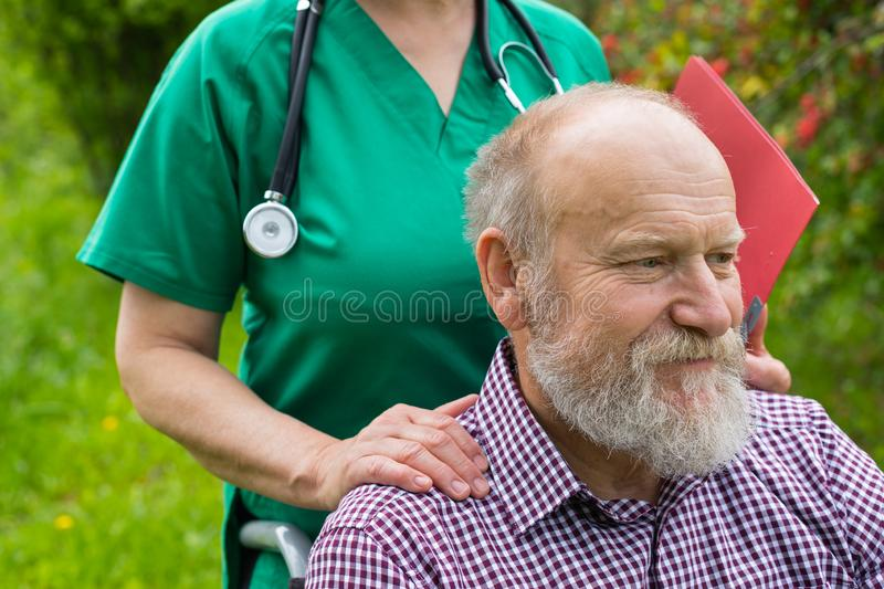 Mature invalid man outdoor stock photography
