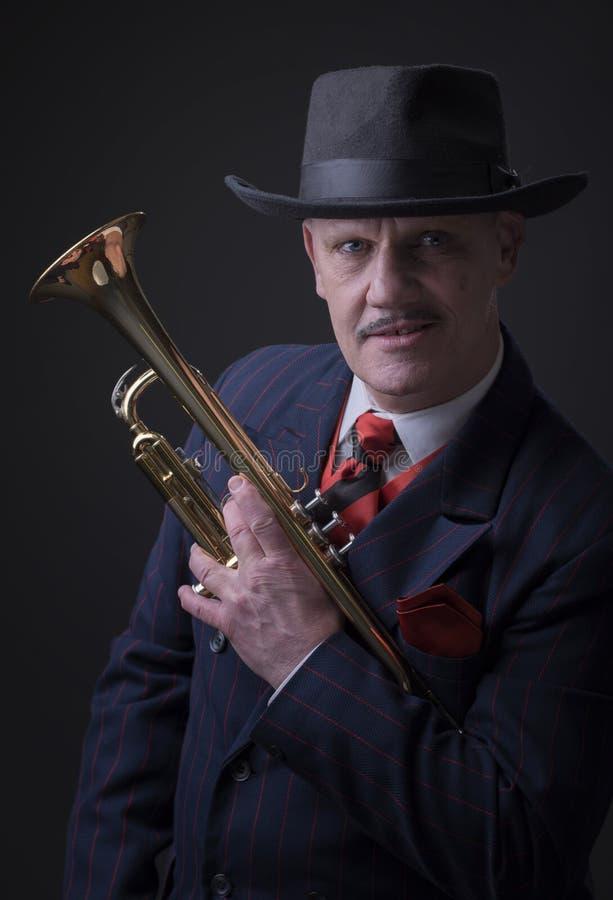 Mature Jazz man holding a trumpet royalty free stock image