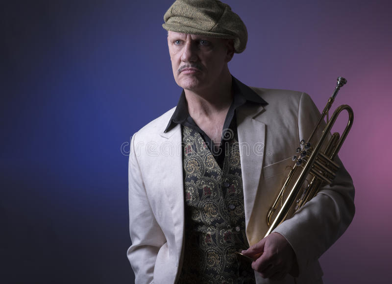 Mature jazz man with a trumpet royalty free stock photography
