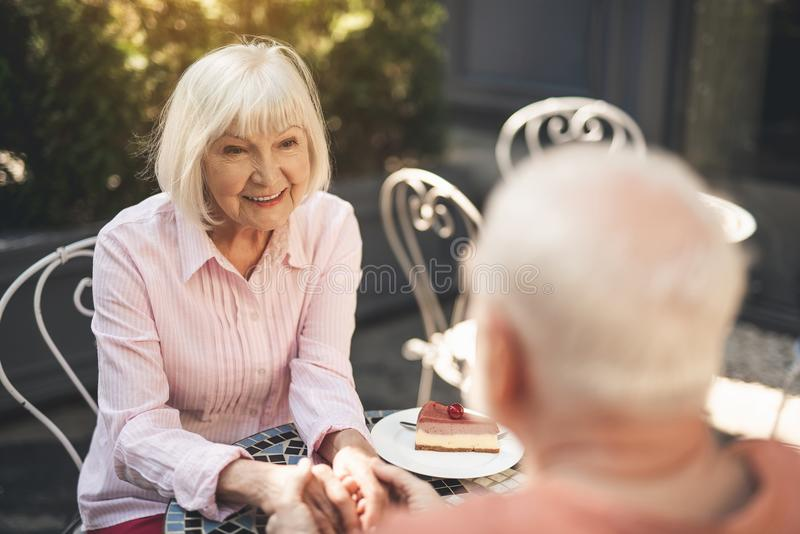 Mature lady and man eating outside royalty free stock image