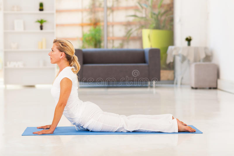 Mature lady yoga royalty free stock images