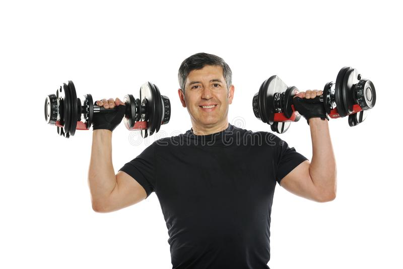 Mature latin man working out. With weights isolated on a white background stock photo