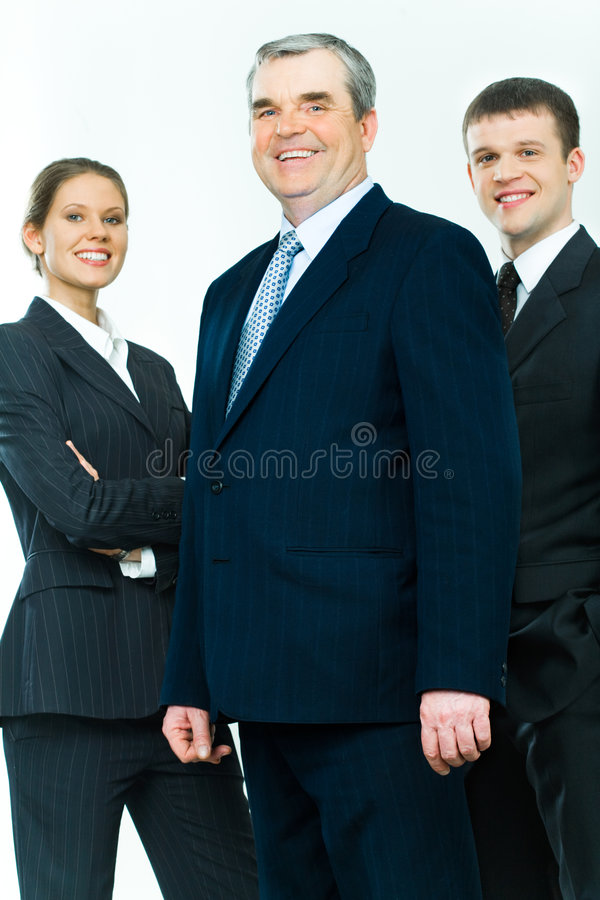 Mature leader. Portrait of business team with mature leader in front stock photography