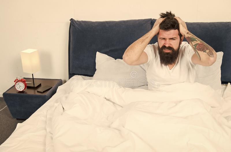 Mature male with beard in pajama on bed. brutal sleepy man in bedroom. asleep and awake. Too early to wake up. energy. And tiredness. Sleepy bearded man hipster royalty free stock photo