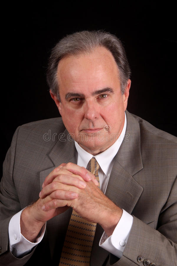 Mature male businessman with a serious expression royalty free stock photos