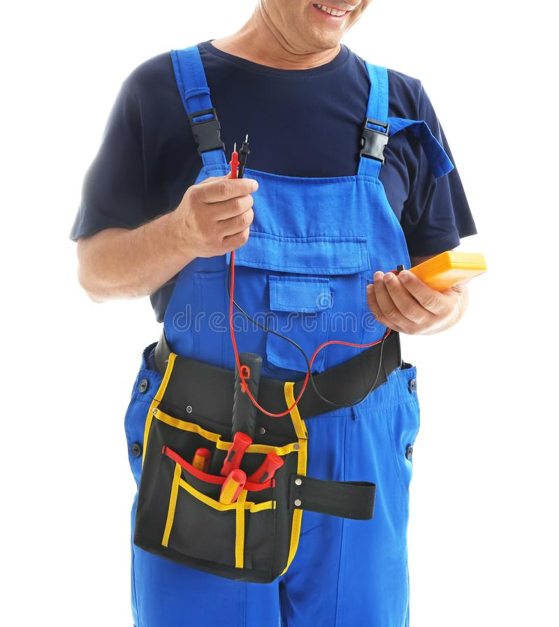 Mature male electrician with multimeter on white background royalty free stock photos