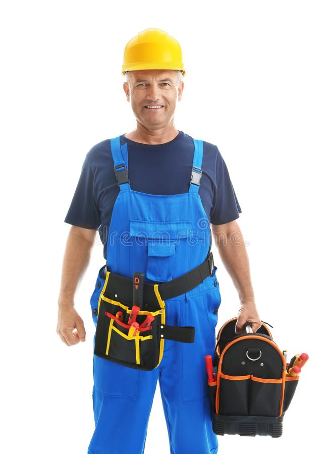Mature male electrician with tools bag on white background stock images