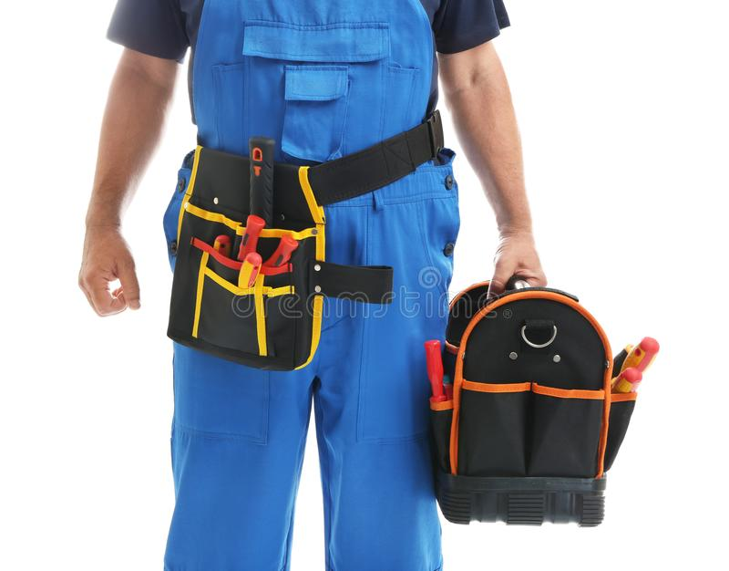 Mature male electrician with tools bag on white background royalty free stock image