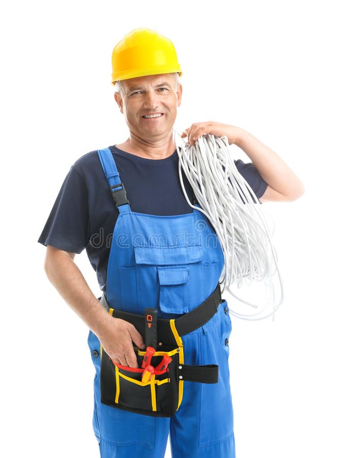 Mature male electrician on white background stock photo