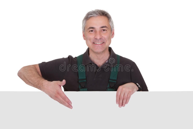Mature male gardner holding placard royalty free stock image