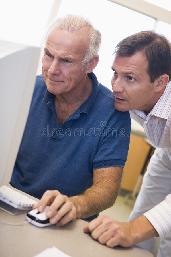Download Mature Male Student Learning Computer Skills Stock Photo - Image of college, evening: 5948110
