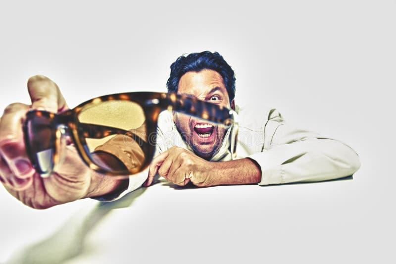 Mature male taking his sunglasses off stock photo