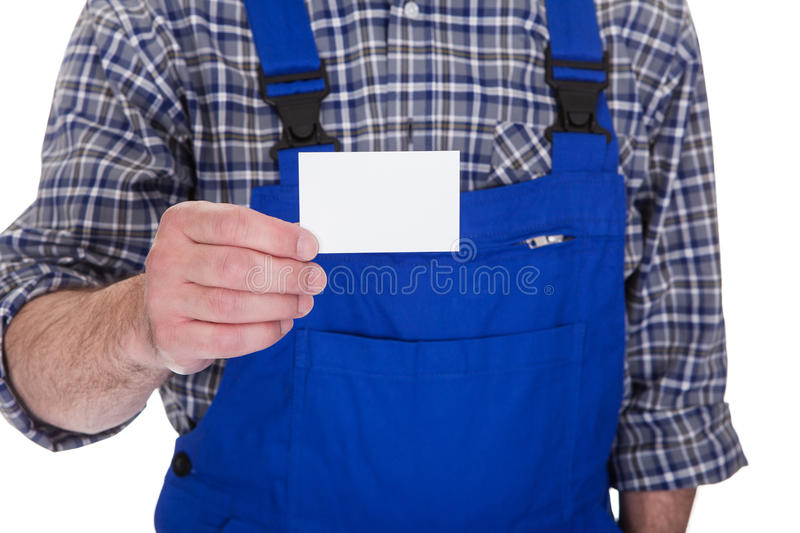 Mature Male Technician Holding Visiting Card royalty free stock photo
