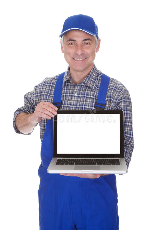 Mature male technician showing laptop. Over White Background stock photos