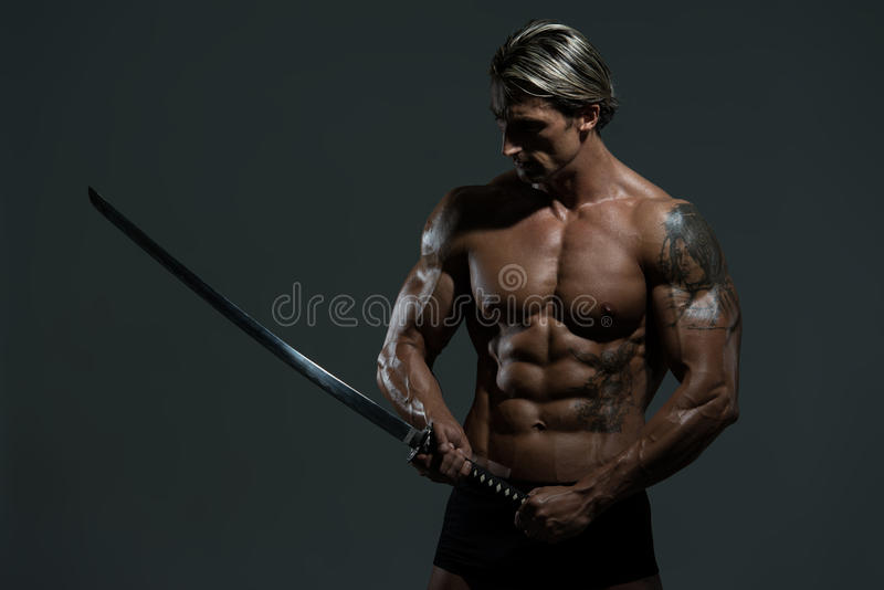 Mature Man In Action With Sword stock photo