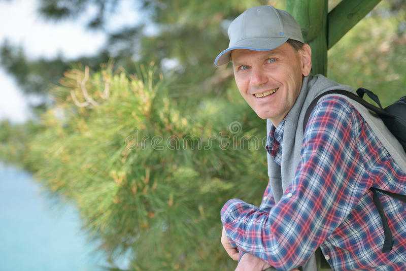 Mature man in the arbor royalty free stock photos