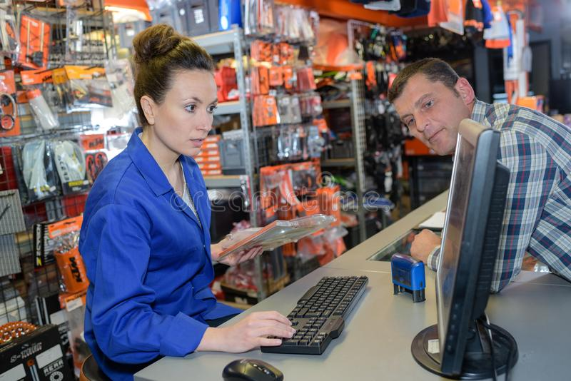 Mature man buys engine clutch in auto parts store. Mature men buys engine clutch in auto parts store female stock photos