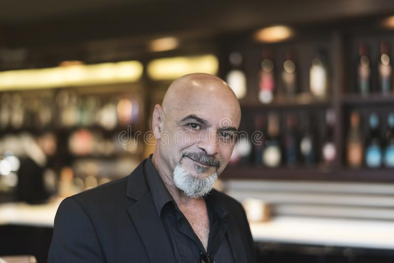 Mature man in a cafe enjoying a relaxing moment stock image
