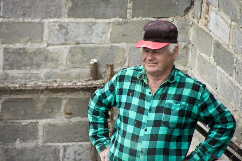 Mature man in check shirt royalty free stock images