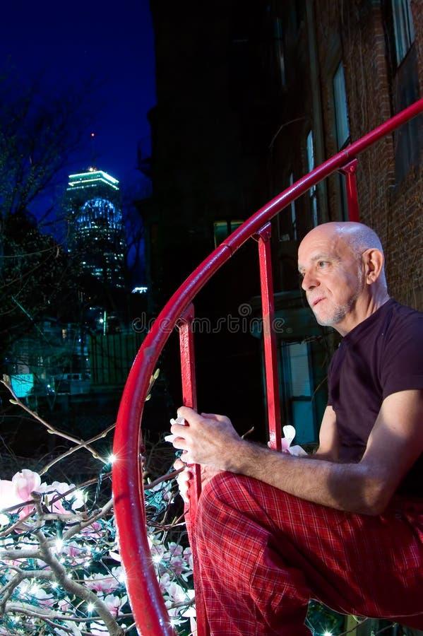 Mature man in city garden