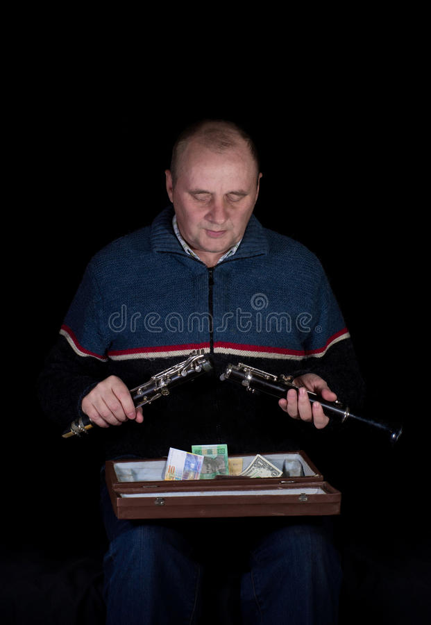 Mature man with clarinet. royalty free stock photos