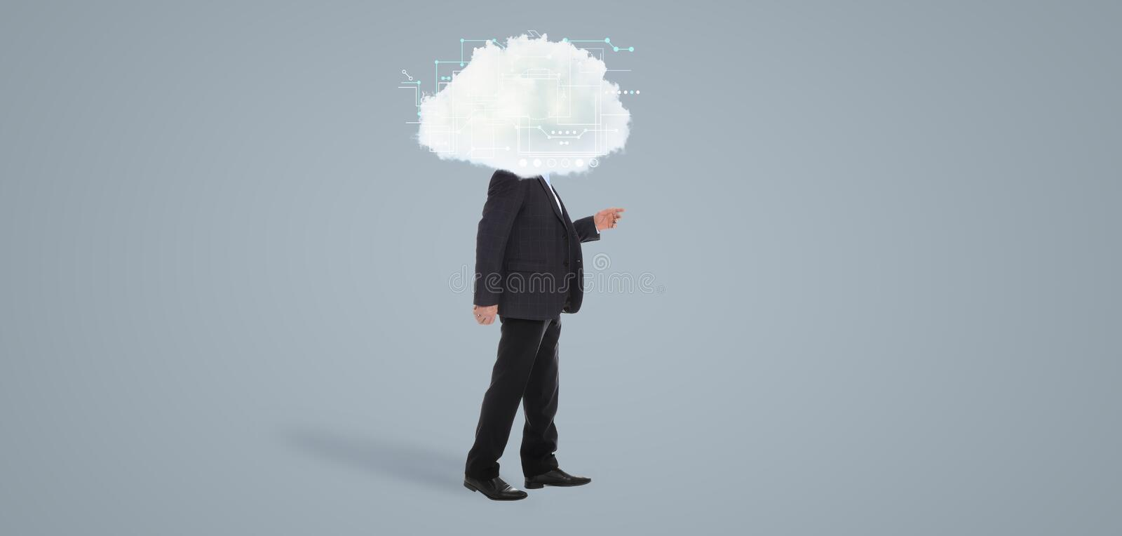 Mature man with cloud on his head against background. Modern storage technology concept. Mature man with cloud on his head against grey background. Modern stock images