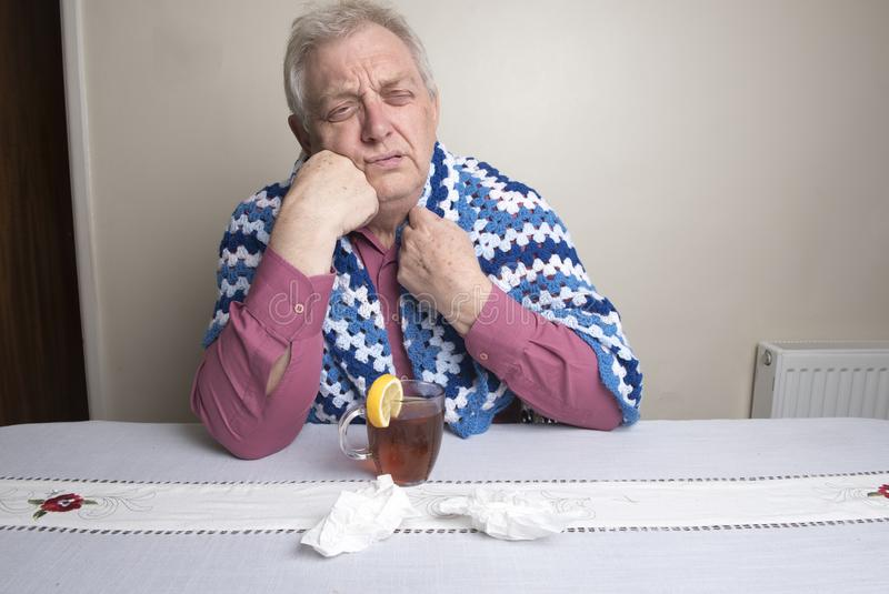 Mature man with a cold stock images