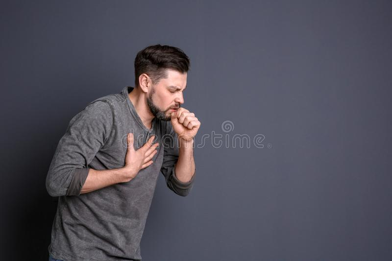 Mature man coughing on background royalty free stock photos