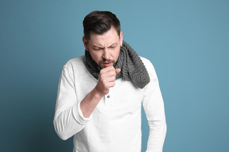 Mature man coughing on background royalty free stock photo