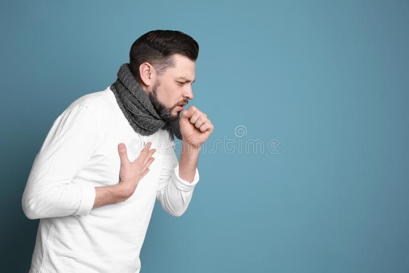 Mature man coughing stock images