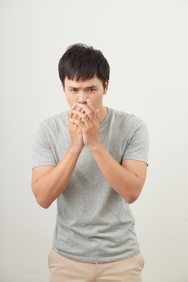 Mature man coughing on white background stock photography